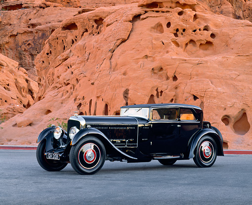 AUT 19 RK0420 02 © Kimball Stock 1930 Bentley Speed Six Corsica Coupe 3/4 Side View On Pavement By Red Rocks