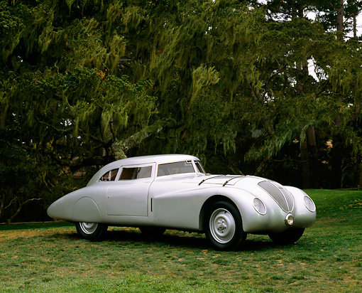 AUT 19 RK0429 02 © Kimball Stock 1937 Adler Rennlimousine Competition Coupe Silver 3/4 Front View On Grass By Trees Pebble Beach