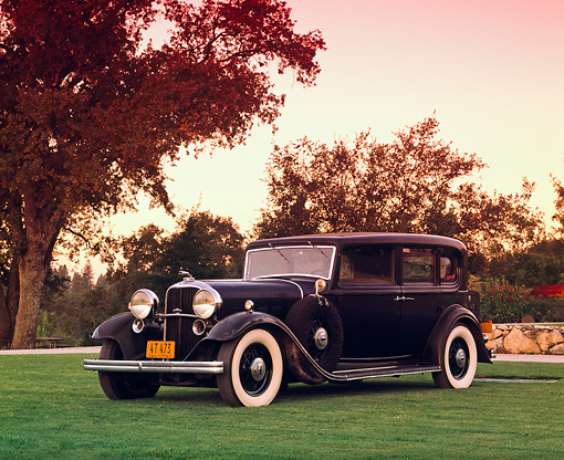 AUT 19 RK0439 02 © Kimball Stock 1932 Lincoln V-12 KB Sedan Black 3/4 Front View On Grass By Trees Filtered
