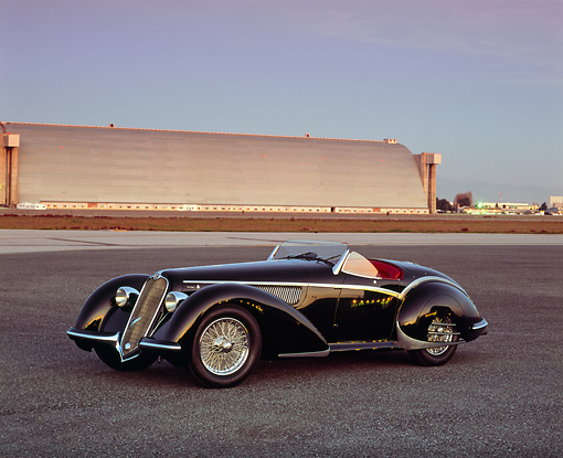 AUT 19 RK0502 03 © Kimball Stock 1937 Alfa Romeo 8C 2900B Spider Black 3/4 Front View On Pavement Airplane Hanger Background