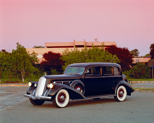 AUT 19 RK0504 01 © Kimball Stock 1936 Pierce Arrow Limo Black 3/4 Side View On Pavement Trees Filtered