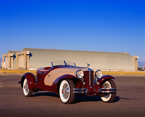 AUT 19 RK0535 05 © Kimball Stock 1931 Cord L29 Speedster Burgundy And Beige 3/4 Front View On Pavement By Airplane Hanger