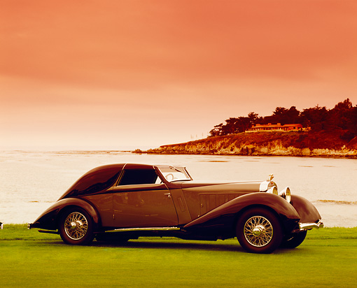 AUT 19 RK0545 01 © Kimball Stock 1934 Hispano-Suiza J12 Coupe de Ville Blue And Gray 3/4 Front View By Water Filtered