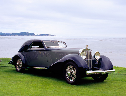 AUT 19 RK0546 01 © Kimball Stock 1934 Hispano Suiza J12 Coupe de Ville Blue And Gray 3/4 Front View By Water