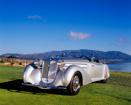 AUT 19 RK0550 02 © Kimball Stock 1938 Horch 853A Sport Cabriolet Silver Low 3/4 Front View On Grass By Water