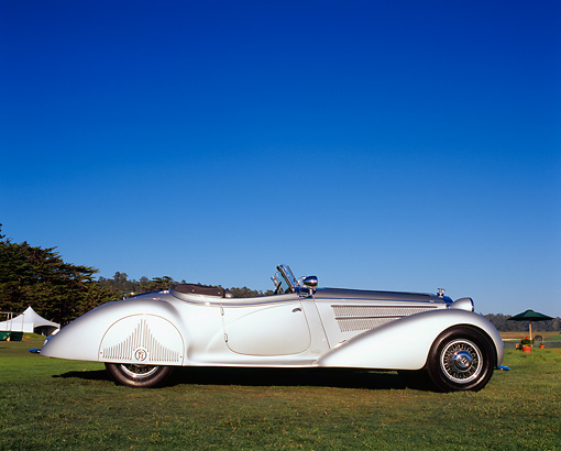 AUT 19 RK0552 02 © Kimball Stock 1938 Horch 853A Sport Cabriolet Silver Profile View On Grass Blue Sky