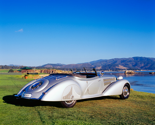 AUT 19 RK0554 01 © Kimball Stock 1938 Horch 853A Sport Cabriolet Silver 3/4 Rear View On Grass By Water