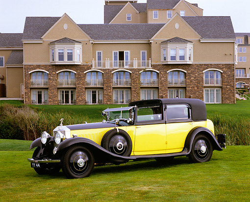AUT 19 RK0574 05 © Kimball Stock 1931 Rolls Royce Phantom II Black And Yellow 3/4 Front View On Grass By Mansion