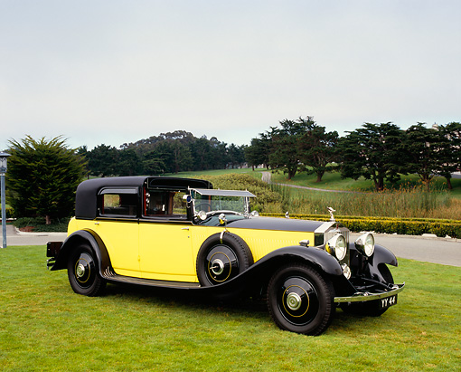 AUT 19 RK0576 07 © Kimball Stock 1931 Rolls Royce Phantom II Yellow And Black 3/4 Front View On Grass