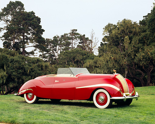 AUT 19 RK0581 06 © Kimball Stock 1939 Rolls Royce Phantom III Labourdette Drophead Red 3/4 Side View On Grass By Building With Columns