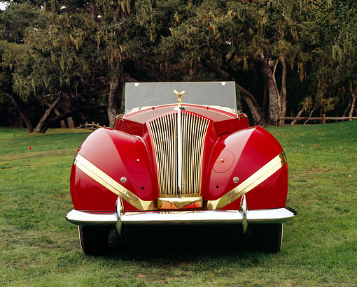 AUT 19 RK0583 03 © Kimball Stock 1939 Rolls Royce Phaeton III Labourdette Drophead Red Head On Shot On Grass By Trees