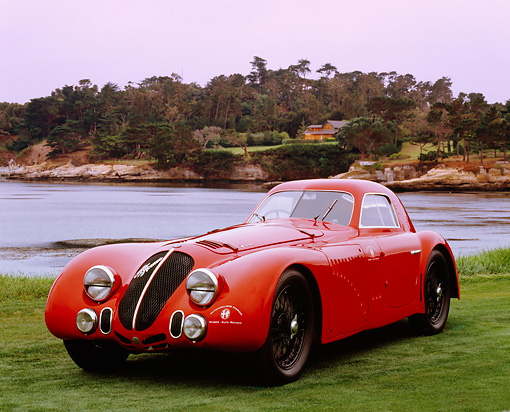 AUT 19 RK0587 02 © Kimball Stock 1938 Alfa Romeo 8C 2900B Red 3/4 Front View On Grass By Water