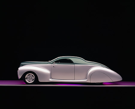 AUT 19 RK0620 02 © Kimball Stock 1939 Lincoln, Zephyr, Almond Green And Silver Profile View On Purple Floor Studio