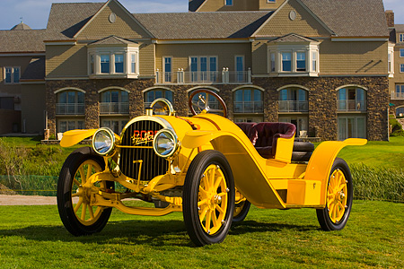 AUT 19 RK0622 01 © Kimball Stock 1913 Pope Hartford Portola Roadster Yellow 3/4 Front View On Grass By Mansion