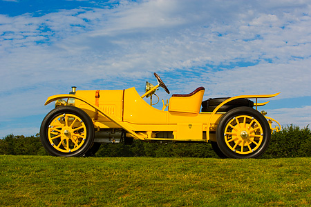 AUT 19 RK0623 01 © Kimball Stock 1913 Pope Hartford Portola Roadster Yellow Low Profile View On Grass