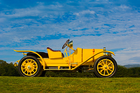 AUT 19 RK0624 01 © Kimball Stock 1913 Pope Hartford Portola Roadster Yellow Profile View On Grass