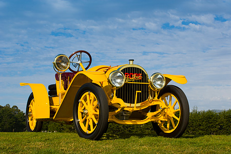 AUT 19 RK0625 01 © Kimball Stock 1913 Pope Hartford Portola Roadster Yellow Low 3/4 Front View On Grass