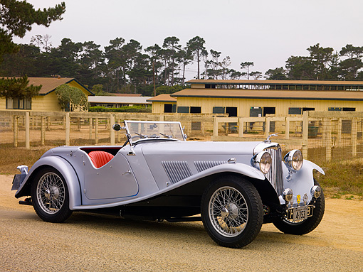 AUT 19 RK0645 01 © Kimball Stock 1938 AC 16/90 Compitition Sports Supercharged Silver Front 3/4 View On Pavement