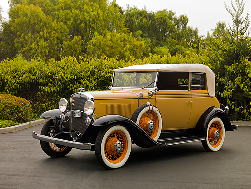 AUT 19 RK0646 01 © Kimball Stock 1931 Chevrolet Landau Phaeton Cream And Brown 3/4 Side View On Pavement By Trees