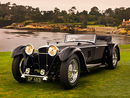 AUT 19 RK0649 01 © Kimball Stock 1931 Daimler Double-Six 50 Corisica Drophead Coupe Black 3/4 Front View On Grass By Water