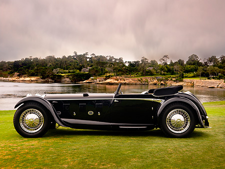 AUT 19 RK0651 01 © Kimball Stock 1931 Daimler Double-Six 50 Corisica Drophead Coupe Black Profile View On Grass By Water