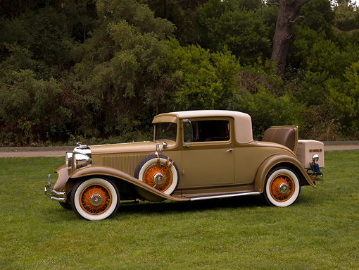 AUT 19 RK0658 01 © Kimball Stock 1931 Chrysler CD8 Coupe Tan And Brown 3/4 Side View On Grass Trees Background