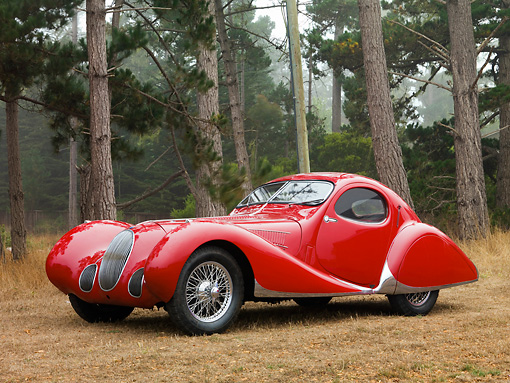 AUT 19 RK0693 03 © Kimball Stock 1938 Talbot-Lago T150C SS Teardrop Coupe Red 3/4 Front View On Dirt By Trees