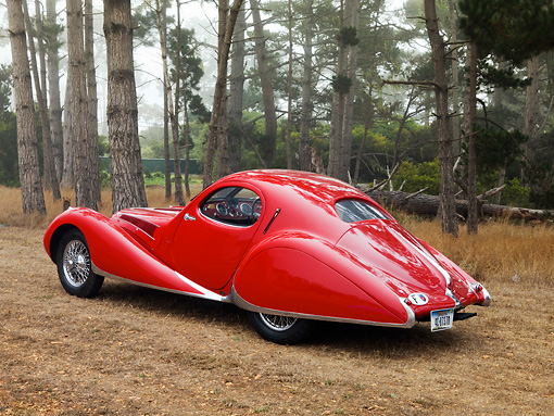 AUT 19 RK0695 01 © Kimball Stock 1938 Talbot-Lago T150C SS Teardrop Coupe Red 3/4 Rear View On Dirt By Trees