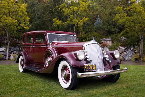 AUT 19 RK0700 01 © Kimball Stock 1933 Pierce-Arrow 1236 Twelve Sedan Brown Front 3/4 View On Grass By Trees