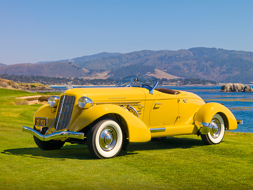 AUT 19 RK0718 01 © Kimball Stock 1935 Auburn 851 Speedster Yellow 3/4 Front View On Grass By Water