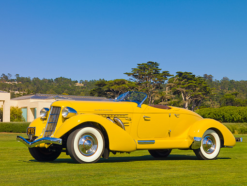 AUT 19 RK0721 01 © Kimball Stock 1935 Auburn 851 Speedster Yellow 3/4 Front View On Grass