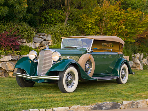 AUT 19 RK0724 01 © Kimball Stock 1933 Lincoln KB Sport Phaeton Green 3/4 Front View On Grass By Trees