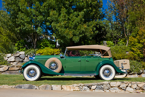 AUT 19 RK0726 01 © Kimball Stock 1933 Lincoln KB Sport Phaeton Green Profile View On Grass By Trees