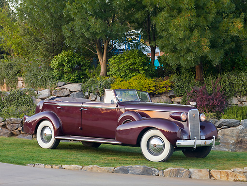 AUT 19 RK0734 01 © Kimball Stock 1937 Cadillac 7529 Convertible Maroon 3/4 Front View On Grass By Trees