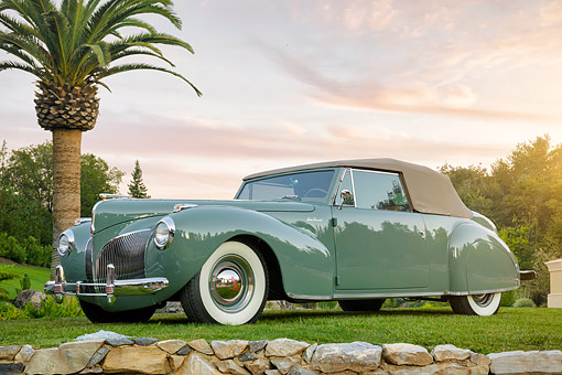 AUT 20 BK0006 01 © Kimball Stock 1941 Lincoln Continental Convertible Green 3/4 Front View By Palm Tree