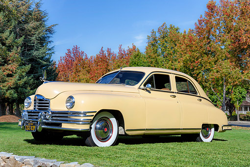 AUT 20 BK0008 01 © Kimball Stock 1948 Packard Deluxe 8 Yellow 3/4 Front View On Grass By Autumn Trees