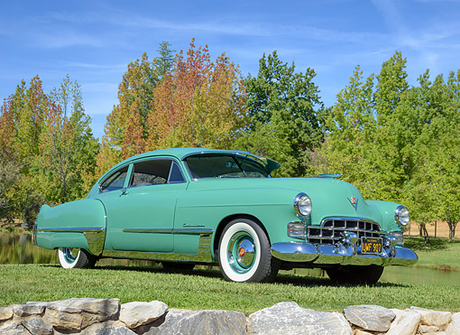 AUT 20 BK0011 01 © Kimball Stock 1948 Cadillac Series 62 Green 3/4 Front View On Grass By Trees