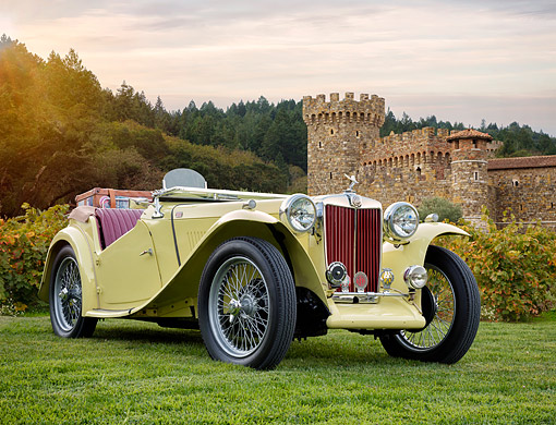 AUT 20 BK0012 01 © Kimball Stock 1949 MG TC Yellow 3/4 Front View On Grass By Castle