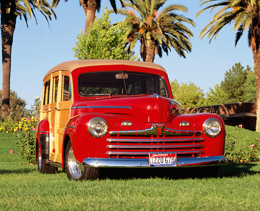 AUT 20 RK0030 03 © Kimball Stock 1946 Ford Woody Red Low 3/4 Front View On Grass
