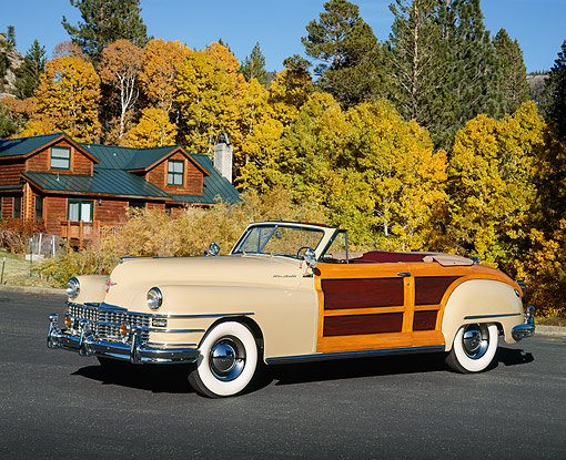AUT 20 RK0071 03 © Kimball Stock 1948 Chrysler Town & Country Tan Convertible 3/4 Side View On Pavement By Cabin And Autumn Trees