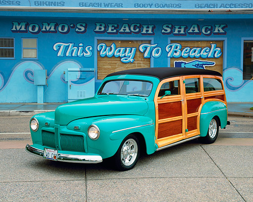 AUT 20 RK0172 02 © Kimball Stock 1942 Ford Woodie Green 3/4 Front View On Pavement By Beach Shack