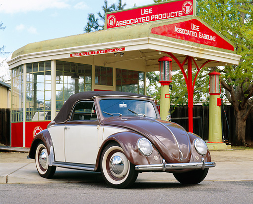 AUT 20 RK0190 01 © Kimball Stock 1949 Hebmuller VW Bug Convertible Cream And Brown Front 3/4 View By Antique Gas Station