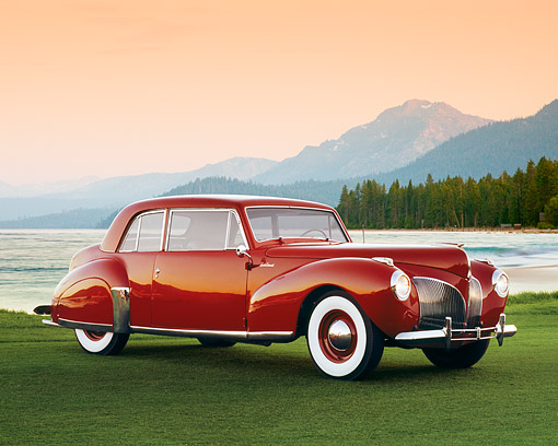 AUT 20 RK0256 04 © Kimball Stock 1941 Lincoln Continental Coupe Red 3/4 Side View On Grass By Water
