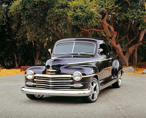 AUT 20 RK0280 01 © Kimball Stock 1946 Plymouth Coupe Purple Front 3/4 View On Pavement By Trees