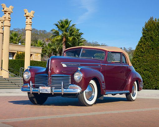 AUT 20 RK0356 01 © Kimball Stock 1941 Hudson Commodore 8 Convertible Maroon 3/4 Front View On Brick By Columns