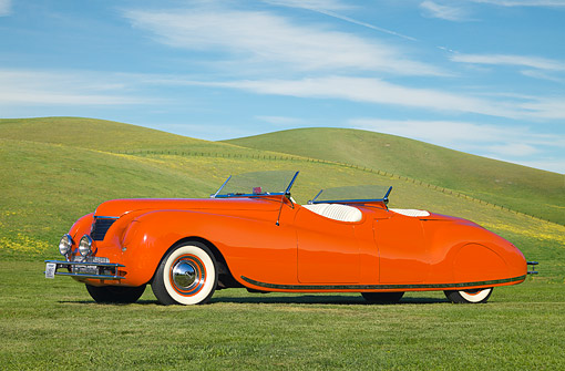 AUT 20 RK0360 01 © Kimball Stock 1941 Chrysler Newport Dual Cowl Phaeton Red 3/4 Side View On Grass By Hills