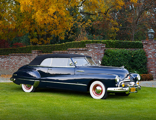 AUT 20 RK0365 01 © Kimball Stock 1948 Buick Roadmaster Convertible Blue 3/4 Front View On Grass By Autumn Trees