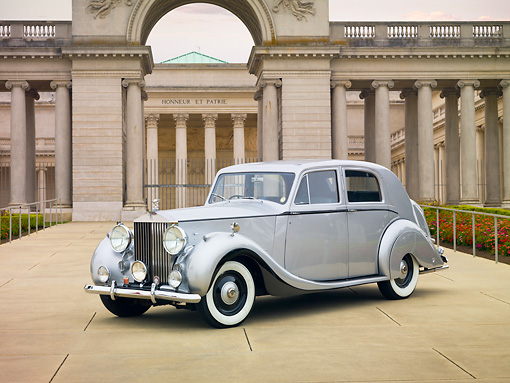 AUT 20 RK0377 01 © Kimball Stock 1948 Rolls-Royce Silver Wraith Silver 3/4 Front View On Pavement By Building
