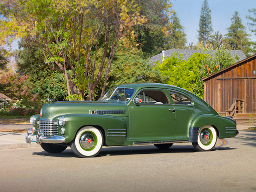 AUT 20 RK0385 01 © Kimball Stock 1941 Cadillac Series 61 Coupe Green 3/4 Front View On Pavement By Trees