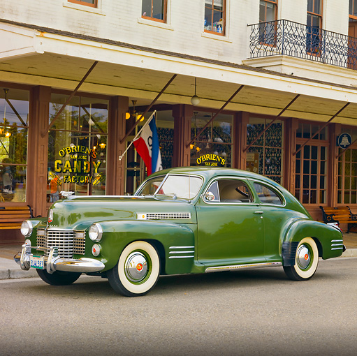 AUT 20 RK0386 01 © Kimball Stock 1941 Cadillac Series 61 Coupe Green 3/4 Front View On Pavement By Store
